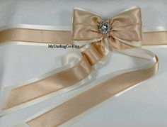 Features: An Elegant Bridal Sash with Large Satin Double Bows.  Embellished with a Glittering Rhinestone Center. #299 S    Made from High