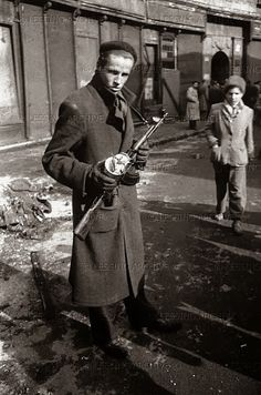 Hungarian Revolution Of 1956. The fighter holds a captured Soviet 2nd production type AK-47.