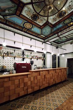 love the colorful tiles and the wood block tiles on the bar front Fleischerei Bar | Leipzig, Germany