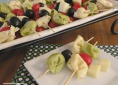 Tortellini marinated in Italian dressing and skewered with olives and cheese.  Looks like a nice appetizer.