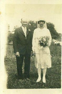 1920s Farm Wedding Photo Bride Flapper Dress Skirt Top Bouquet Veil Standing in Front of Field Pasture Photograph