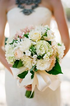 Nada's bouquet of dahlias accented with bright green leaves, created by Simple Flowers, was tied with a white satin ribbon.