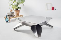 The Sekkai Table by Kim Haagen arises from a single sheet of steel. Scandinavian Furniture, Contemporary Furniture, Mirrored Side Tables, Stainless Steel Sheet, Funky Design, Creative Design, Design Research, Design Strategy, Sustainable Design