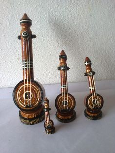 Different sizes of musical instrument these are made with waste papers cut into quilling strips (quilling art)