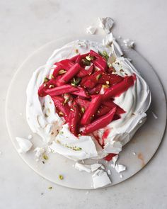 Baby Shower Cakes: It's hard to believe that a dessert this elevated is made from such basic ingredients: sugar, egg whites, and vanilla. It is also a lovely study in contrasts: the delicate, crisp exterior; the ephemeral interior; and here, soft, sweet-tart rhubarb and crunchy pistachios. Happy spring.