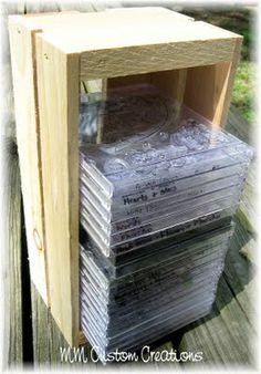 Store your clear stamps in CD's and organize them on your table with a CD holder (or wooden box?)