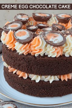 Recipe for a Creme Egg Chocolate Cake - a moist and delicious chocolate cake with two coloured buttercream and lots of Creme Eggs! #cremeeggs #thebakingexplorer #chocolatecake #eastercake #easterbaking