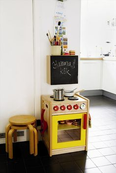 play kitchen off in one corner of the kitchen to keep little ones out of the danger zone!