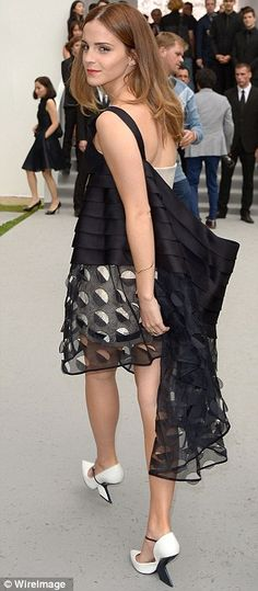 Stand out: Emma certainly made for an eye-catching guest on the front row...