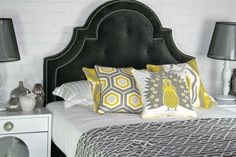 charcoal headboard, yellow and white accents. Love it all.