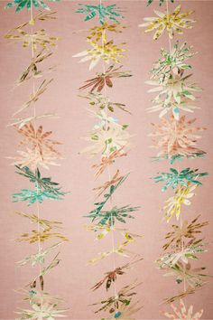 Flora Petal Garland from BHLDN. Great for creating a ceremony backdrop or hung over a table of sweets.