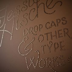 THis is a pretty simple but awesome way to personalize a wall. Trace out the words or phrase that you want displayed then get brass tacks and pin them over the words.