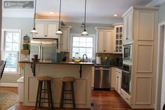 From Yellow to Blue: a Kitchen Transformation.  Restoration Hardware - Silver Sage for the walls.  Photos at:  http://unskinnyboppy.com/2011/07/from-yellow-to-blue-kitchen/