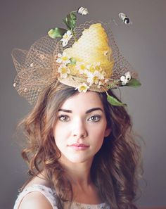 Are you looking for a very unique headpiece for your event ? This is a super sweet & whimsical bee hive & flower fascinator & its even ready