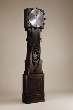Tall Clock  Made by Charles Rohlfs  (American, Brooklyn, New York 1853–1936 Buffalo, New York)  Date: ca. 1900