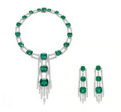 Harry Winston Emerald Drop Necklace and Emerald Drop Earrings feature 24 emeralds that are perfectly matched in size, shape and color.