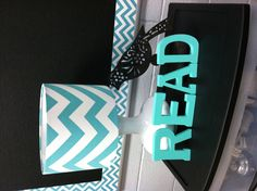 ANOTHER PINNER SAID... Making my classroom feel warm, cozy and organized.  I want it to feel like home, since i work there all day! Aqua Chevron Lamp from Michaels, Bulletin board borders/trim from CTP, painted wood block letters from Michaels, black rolling cart from Walmart