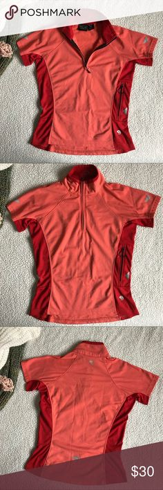Women's Cycling Short Sleeve This is an XS mountain hard ware cycling short sleeve in the color coral and orange. There is a zipper pocket in the left side of the shirt where you can store your essentials like and identification card, keys, a lock, anything! It also has four reflecting triangles, two on each side of the abdomen, two on the short sleeve and one in the back.  MEASUREMENTS -Length: 21.5 inches  -Arm Length: 10 inches  -Chest: 17 inches  -Chest Zipper opening: 8.5 inches   SHIPS…
