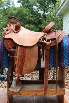 Floral carved half breed Keith Valley Wade Saddle for Sale - For more information click on the image or see ad # 33910 on www.RanchWorldAds.com