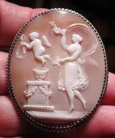 """Victorian Carved Bullmouth Helmet Shell Cameo Depicting """"Venus And Cupid"""", Mounted In Silver - Probably Italian   c.1860"""