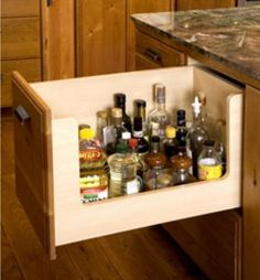 """a """"Chef Drawer"""" -- handier than a lazy susan -- cooking oils and sauces in a deep drawer with a u-shaped cutout for visibility. copyright Richard Landon, spaceplanner.com. Accessible too!"""