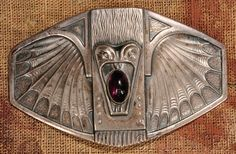 ROBERT KRAFT Art Nouveau / Secessionist belt buckle, c. 1905, decorated with a grotesque fish or bat, German silver with glass cabochon, 3-3/8 in. wide