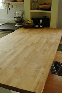 On-the-cheap reno for your kitchen: replace a portion of your countertop w/ Ikea butcherblock. It adds warmth, softness, and is great for an eating bar.  $200  hmm - I like butcher block but how durable is it for counters I wonder