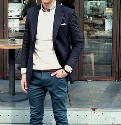Go for a black blazer and navy chinos to create a smart casual look.  Shop this look for $103:  http://lookastic.com/men/looks/longsleeve-shirt-and-pocket-square-and-crew-neck-sweater-and-blazer-and-belt-and-chinos/3803  — Grey Longsleeve Shirt  — White Pocket Square  — White Crew-neck Sweater  — Black Blazer  — Burgundy Leather Belt  — Navy Chinos