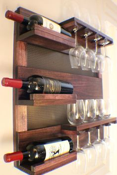 *****This is a MADE TO ORDER listing. You will receive a wine rack the same as the one pictured above but this one already has a home.***** THIS WINE RACK IS FOR WHITE WINE AND STANDARD RED WINE GLASSES. THE LARGEST THE FOOT OF YOUR GLASSES CAN BE IS 3. If you have large red wine, glasses then this wine rack will not work for you. For this listing you will receive a stunning wine rack just like the one shown above. You get to choose your stain color and your decorative mesh color. Its made…