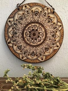 Pyrographed Henna-style mandala to hang on your wall . Mandala measures 6 inches in diameter and is inch thick. Waxed umber hemp gives a rustic appeal for hanging. Thanks for stopping by! Wood Burning Crafts, Wood Burning Patterns, Wood Burning Art, Wood Crafts, Diy Crafts, Wood Painting Art, Mandala Painting, Wood Art, Wood Wood