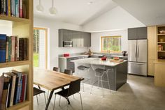 GO Logic design the Cousins River Wooden Residence near a pine forest in southern Maine - CAANdesign Building A Wooden House, Green Building, Building Ideas, Building Design, Passive House Design, Logic Design, Kitchen Island With Seating, Prefab Homes, Maine House