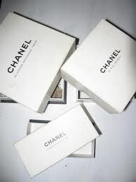 White chanel boxes with colored ribbon