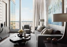 """- Downtown Manhattan Residence """"This large-scale project began as two apartments that we combined to create a full floor 7,300 sq. ft. unit with endless 360-degree views of Manhattan and beyond. Completely reconsidering the layout was required, and the six bedrooms were reduced to four, allowing a wine room, a gym, and a spacious home office, as well as two open great rooms for living."""" Condo Living Room, Living Rooms, Custom Dining Tables, Design Salon, Bedroom Layouts, Headboard And Footboard, Wall Treatments, Architectural Digest, Furniture Making"""