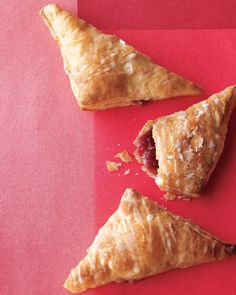 The perfect picnic dessert, hand pies are simplified when made with puff pastry. These strawberry-jam-filled versions have a tangy glaze on top.