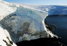 Melting ice shows through at a cliff face at Landsend, on the coast of Cape Denison in Antarctica January 2, 2010. REUTERS/Pauline Askin