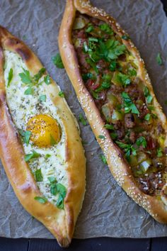 Turkish Pide (Turkish Pizza: 2 ways) Turkish Pide (aka pizza) is a Turkish comfort food favorite! Here are 2 different fillings, one with meat and peppers and the other with cheese and egg. Comida Armenia, Turkish Pizza, Good Food, Yummy Food, Eastern Cuisine, Turkish Recipes, Romanian Recipes, Arabic Recipes, Scottish Recipes
