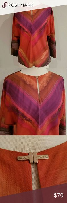 Beautiful TED BAKER London Keyhole  Top Stunning! A Gorgeous Ted Baker top! With wide sleeves and a sassy Keyhole Slit front that has a gold signed locking clasp closure.  Purchased new and never wore! Authentic Ted Baker London Tops