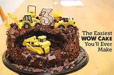 Construction Cake: To assemble, simply cut a chunk out of the cake and arrange the construction vehicles on it to appear as though they're working on it – dig down with the shovels, plunge in with the fork lifts, etc.  If you're not looking to surprise your little one, it's fun to let them help set up the scene.