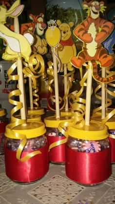 Winnie the pooh center pieces. Used recycled baby food jars. Simple and cute.. And saved some $$