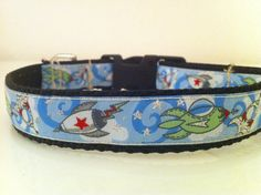 Elton totally needs this. Rocket Ship Dog Collar by abitofcollar on Etsy, $18