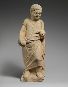 Limestone statuette of a boy holding a duck. Culture: Cypriot. Medium: Limestone