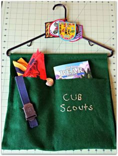 No Sew Cub Scout Hanging Organizer Easy to make and keep all those random scouts things in one place! {Life as a Field Trip} No Sew Cub Scout Hanging Organizer Easy to make and keep all those random scouts things in one place! {Life as a Field Trip} Cub Scout Law, Cub Scout Uniform, Cub Scouts Wolf, Beaver Scouts, Tiger Scouts, Scout Mom, Scout Leader, Girl Scouts, Cub Scout Skits