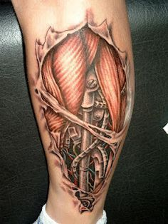 bio-mechanical tattoo on the calf