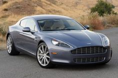 The Aston Martin Rapide is a high-performance sports saloon has been in the market since With a top-speed this four-door tourer is amazing. Aston Martin Rapide, Aston Martin Vanquish, Aston Martin Vantage, Mercedes Gl, My Dream Car, Dream Cars, Little Red Corvette, Sports Sedan, Limousine