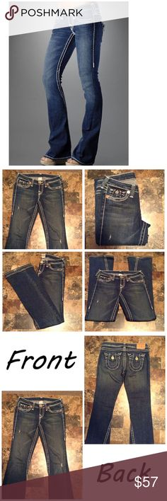 """True Religion Joey Big T Jeans First pic of model wearing this style of Jeans. Last 3 pics are of actual item/color. Size 28. Made of 99% cotton and 1% Elastane. Flap pocket design. Flare. Laying flat """"14. Rise """"8.5. Length """"43. Leg Opening """"9.5. Inseam """"34. True Religion Jeans Flare & Wide Leg"""