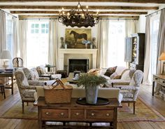 The Enchanted Home: Rustic, rambling and refined country chic. Salvaged beams and floors give this room a timeless and aged but graceful feel