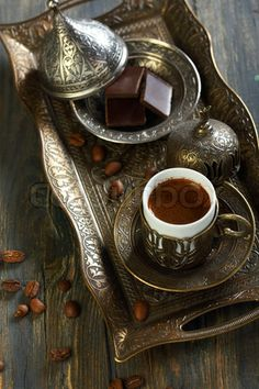 Image of 'Beautiful bronze set for Turkish coffee on the old table.'