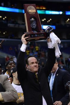 Gregg Marshall, Head Coach of the Wichita State Shockers Men's basketball team holding the West Regional trophy.  The Shockers beat the #8, #13, #1 & #2 seeds in their region.