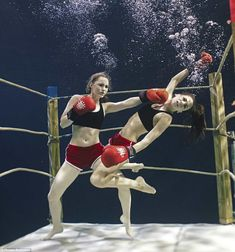Two female boxers spar underwater for a commercial.  photo by Phoebe Rudomino.  part of the Water on the Lens exhibit by Pinewood Studios.