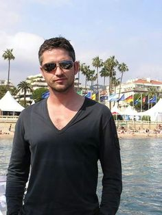 Gerard Butler, male actor, celeb, water, beach, sunglasses, beard, macho, powerful face, intense, sexy, portrait, photo